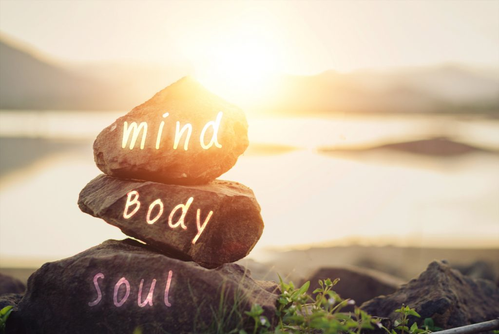 """stones that read """"mind,"""" """"body,"""" and """"soul"""" 